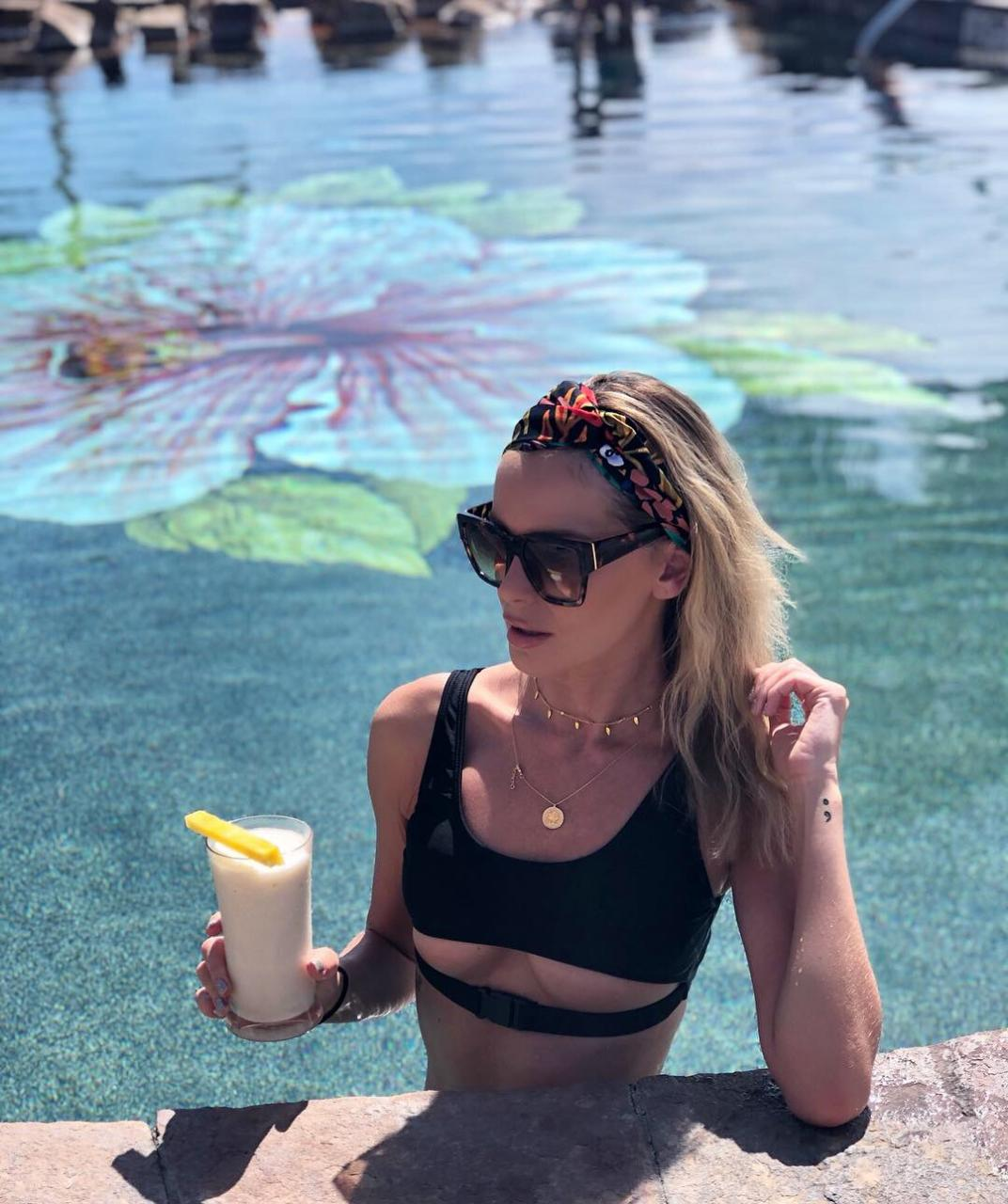 Lounging in one of the many pools with a Piña in hand!